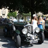 Classic cars with fashion show models in the town square
