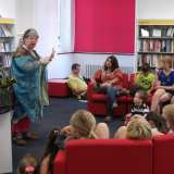 Chloe the Midnight Story Teller spins tales of Dragons in the Library