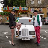 Mayor, Ben Eddolls and Chauffeuse, councillor Jo Davies pose in front of the mayoral Rolls