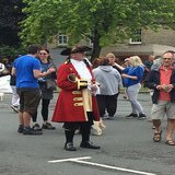Ken Brightwell the Town Crier very popular with the tourists for photo opportunities