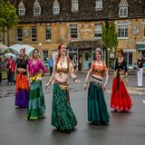 'Rose hips' belly dancing troupe join in with the Morris dancers